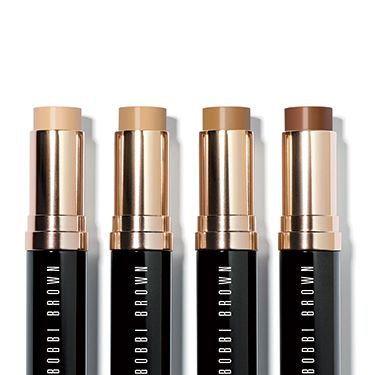 """<p>A no-brainer for makeup fans, a face base is a must, and with so many to choose from, there is something for everyone. If you want high, flawless coverage, foundation is for you, while a BB cream is subtler and lightly veils your pores. You can't go wrong with <a href=""""http://www.bobbibrown.co.uk/cms/collection/skin_foundation_stick.tmpl?cm_re=Gnav-_-WhatsNew-_-FoundationStick"""" target=""""_blank"""">Bobbi Brown's Skin Foundation Stick, £29</a> – it's a classic that's been reformulated for a more weightless feel. Best of all, it's fuss-free and can tuck in your handbag too, so you can whip it out while you're on the go and give your skin a fix.</p><p><a href=""""http://cosmopolitan.co.uk/beauty-hair/news/trends/beauty-products/ten-best-makeup-tools-essential-brushes-tweezers-and-curlers-for-your-makeup-bag?click=main_sr"""" target=""""_blank"""">COSMO'S 10 BEST MAKEUP TOOLS</a></p><p><a href=""""http://cosmopolitan.co.uk/beauty-hair/beauty-teams-essential-makeup-96776?click=main_sr"""" target=""""_blank"""">THE BEAUTY TEAM'S ESSENTIAL MAKEUP</a></p><p><a href=""""http://cosmopolitan.co.uk/beauty-hair/beauty-blog/twins_cassie_and_connie_compare_makeup_bags_for_cosmopolitan_beauty-lab?click=main_sr"""" target=""""_blank"""">TWIN TRIALS: OUR MAKEUP BAG MUST-HAVES</a></p>"""