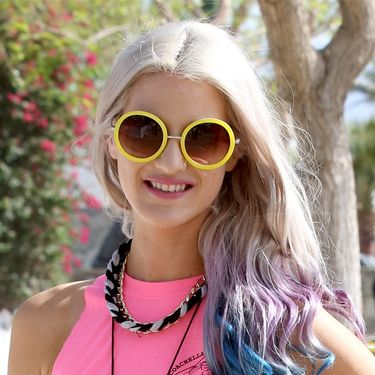 <p>Pretty meets tough with these streaks of blue and purple through blonde locks, and you can fake it with colour chalks  if you have light, longer hair. The curls give it a glossy effect that looks perfectly groomed, and even when they start to drop, they'll twist into beachy waves. </p>