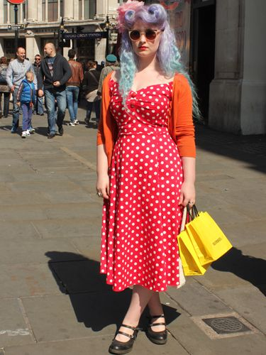 """<p>Harriet, student.</p> <p>Collectif polka dot dress, Dr. Martens boots, Primark flower hair accessory.</p> <p><a href=""""http://www.cosmopolitan.co.uk/fashion/shopping/Coachella-festival-street-style-2014-pictures"""" target=""""_blank"""">SEE HOW THEY'RE WEARING IT AT COACHELLA 2014</a></p> <p><a href=""""http://www.cosmopolitan.co.uk/fashion/shopping/10-spring-dresses-under-30-pounds-ss14"""" target=""""_blank"""">10 BEST SPRING DRESSES UNDER £30</a></p> <p><a href=""""http://www.cosmopolitan.co.uk/fashion/shopping/5-pastel-trend-accessories-spring-summer-2014"""" target=""""_blank"""">PASTEL-PRETTY ACCESSORIES TO BUY NOW</a></p> <p>Picture by Charlie Ashfield.</p>"""