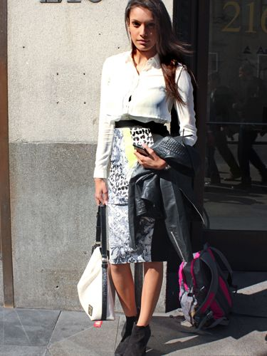 """<p>Natasha, business development manager.</p> <p>River Island digital print pencil skirt, Armani white shirt, Calvin Klein handbag.</p> <p><a href=""""http://www.cosmopolitan.co.uk/fashion/shopping/Coachella-festival-street-style-2014-pictures"""" target=""""_blank"""">SEE HOW THEY'RE WEARING IT AT COACHELLA 2014</a></p> <p><a href=""""http://www.cosmopolitan.co.uk/fashion/shopping/10-spring-dresses-under-30-pounds-ss14"""" target=""""_blank"""">10 BEST SPRING DRESSES UNDER £30</a></p> <p><a href=""""http://www.cosmopolitan.co.uk/fashion/shopping/5-pastel-trend-accessories-spring-summer-2014"""" target=""""_blank"""">PASTEL-PRETTY ACCESSORIES TO BUY NOW</a></p> <p>Picture by Charlie Ashfield.</p>"""