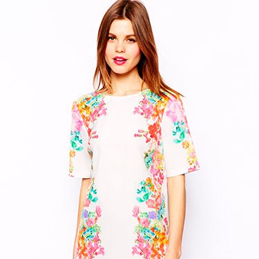 """<p>Obviously wearing white to a wedding is a massive faux pas, but this dress is busily embellished with beautiful watercolour floral prints that you hardly realise it's white in the first place. The best part is that you can accessorise with so many different colours thanks to the varied floral hues. Delicious!</p><p>Mirror floral v back dress, £55, <a href=""""http://www.asos.com/ASOS/ASOS-Mirror-Floral-V-Back/Prod/pgeproduct.aspx?iid=3886135&cid=8799&sh=0&pge=3&pgesize=204&sort=-1&clr=Cream"""" target=""""_blank"""">ASOS</a></p><p><a href=""""http://www.cosmopolitan.co.uk/fashion/shopping/12-incredible-high-street-wedding-dresses-budget"""" target=""""_blank"""">12 INCREDIBLE WEDDING DRESSES FROM THE HIGH STREET</a></p><p><a href=""""http://www.cosmopolitan.co.uk/fashion/shopping/10-spring-dresses-under-30-pounds-ss14"""" target=""""_blank"""">10 SPRING DRESSES ON A BUDGET</a></p><p><a href=""""http://www.cosmopolitan.co.uk/fashion/shopping/Coachella-festival-street-style-2014-pictures"""" target=""""_blank"""">COACHELLA STREET STYLE EDIT</a></p>"""