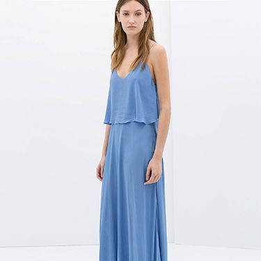 """<p>Maxi dresses can be tricky and can easily look passe and overtly 'boho'. Steer clear of prints and go for one colour, but try to avoid pastels. Although pastels are great for spring dressing, it can be too much on a maxi dress and make you appear washed out. This delicate maxi dress from Zara strikes the perfect balance of relaxed and formal, and the vibrant sky blue is a bold yet subtle hue. Pair with flat sandals or, if you prefer a heel, wear with a small block-heel.</p><p>Long dress with low back, £49.99, <a href=""""http://www.zara.com/uk/en/woman/dresses/long-dress-with-low-back-c358003p1818531.html"""" target=""""_blank"""">Zara</a></p><p><a href=""""http://www.cosmopolitan.co.uk/fashion/shopping/12-incredible-high-street-wedding-dresses-budget"""" target=""""_blank"""">12 INCREDIBLE WEDDING DRESSES FROM THE HIGH STREET</a></p><p><a href=""""http://www.cosmopolitan.co.uk/fashion/shopping/10-spring-dresses-under-30-pounds-ss14"""" target=""""_blank"""">10 SPRING DRESSES ON A BUDGET</a></p><p><a href=""""http://www.cosmopolitan.co.uk/fashion/shopping/Coachella-festival-street-style-2014-pictures"""" target=""""_blank"""">COACHELLA STREET STYLE EDIT</a></p>"""