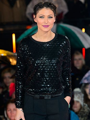 "<p>By jove does that Emma Willis know how to do make up. Her signature cats-eyeliner flick and a vibrant purple libby elevates her all black outfit.</p> <p><a href=""http://www.cosmopolitan.co.uk/fashion/shopping/10-wedding-guest-outfits-from-the-high-street"" target=""_blank"">TEN WEDDING GUEST OUTFITS FROM THE HIGH STREET</a></p> <p><a href=""http://www.cosmopolitan.co.uk/fashion/shopping/celebrity-ad-campaigns-spring-summer-2014-rihanna-lady-gaga-jennifer-lawrence"" target=""_blank"">CELEBRITY SS14 FASHION CAMPAIGNS</a></p> <p><a href=""http://www.cosmopolitan.co.uk/fashion/shopping/Street-style-london-spring-trends-2014-pictures"" target=""_blank"">SPRING STREET STYLE INSPIRATION</a></p>"