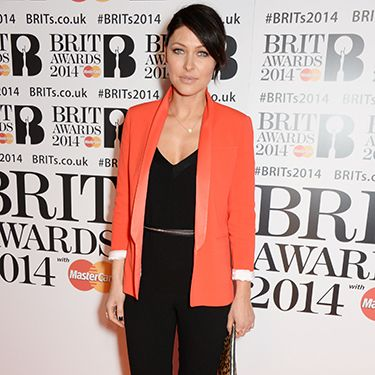 """<p>That Emma sure knows how to rock a blazer&#x3B; we love this bright red tuxedo style against her black jumpsuit at the Brit Awards this year.</p><p><a href=""""http://www.cosmopolitan.co.uk/fashion/shopping/10-wedding-guest-outfits-from-the-high-street"""" target=""""_blank"""">TEN WEDDING GUEST OUTFITS FROM THE HIGH STREET</a></p><p><a href=""""http://www.cosmopolitan.co.uk/fashion/shopping/celebrity-ad-campaigns-spring-summer-2014-rihanna-lady-gaga-jennifer-lawrence"""" target=""""_blank"""">CELEBRITY SS14 FASHION CAMPAIGNS</a></p><p><a href=""""http://www.cosmopolitan.co.uk/fashion/shopping/Street-style-london-spring-trends-2014-pictures"""" target=""""_blank"""">SPRING STREET STYLE INSPIRATION</a></p>"""