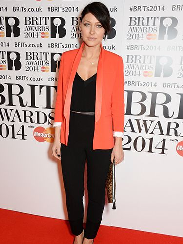 "<p>That Emma sure knows how to rock a blazer; we love this bright red tuxedo style against her black jumpsuit at the Brit Awards this year.</p> <p><a href=""http://www.cosmopolitan.co.uk/fashion/shopping/10-wedding-guest-outfits-from-the-high-street"" target=""_blank"">TEN WEDDING GUEST OUTFITS FROM THE HIGH STREET</a></p> <p><a href=""http://www.cosmopolitan.co.uk/fashion/shopping/celebrity-ad-campaigns-spring-summer-2014-rihanna-lady-gaga-jennifer-lawrence"" target=""_blank"">CELEBRITY SS14 FASHION CAMPAIGNS</a></p> <p><a href=""http://www.cosmopolitan.co.uk/fashion/shopping/Street-style-london-spring-trends-2014-pictures"" target=""_blank"">SPRING STREET STYLE INSPIRATION</a></p>"