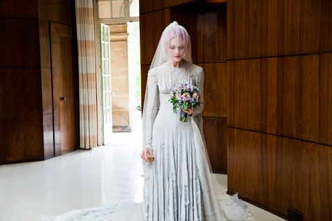 "<p>A stunning pale grey slashed chiffon wedding-dress, designed by Gareth Pugh is worn with a striking veil by milliner, Stephen Jones, 2011.</p> <p><a href=""http://www.cosmopolitan.co.uk/fashion/shopping/12-incredible-high-street-wedding-dresses-budget"" target=""_self"">12 INCREDIBLE HIGH STREET WEDDING DRESSES </a></p> <p><a href=""http://www.cosmopolitan.co.uk/fashion/shopping/short-bridesmaids-dresses-wear-again-uk"" target=""_blank"">SHORT BRIDESMAID DRESSES YOU CAN WEAR AGAIN </a></p> <p><a href=""http://www.cosmopolitan.co.uk/fashion/shopping/10-wedding-guest-outfits-from-the-high-street"" target=""_blank"">10 HIGH STREET WEDDING GUEST DRESSES</a></p>"