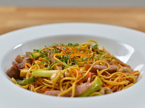 <p>Serves 4-6</p> <p><strong>Ingredients</strong><br />400g (14oz) lean pork, cut into thin strips<br />1 tsp salt<br />400g (14oz) medium Chinese egg noodles<br />400g (14oz) button mushrooms, quartered<br />150g carrots, peeled and finely sliced at an angle<br />1 tbsp soy sauce<br />4 large spring onions, trimmed and cut into 2.5 cm (1 inch) pieces</p> <p><em>For the marinade</em><br />2 cloves of garlic, peeled and finely chopped<br />2 tsp finely grated root ginger<br />3 tbsp groundnut oil<br />1 tsp soy sauce<br />3 tbsp fish sauce (nam pla)<br />3 tbsp caster sugar</p> <p><strong>Method</strong><br />1. Place the pork in a bowl or re-sealable food bag and add all the ingredients for the marinade. Toss the pork to coat evenly and cover the bowl with cling film or seal the bag and leave
