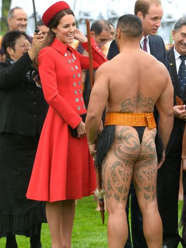 "<p>The Duchess starts her stately visit as she means to go on, looking stunning in a smart red coat dress by Catherine Walker, who was a favourite designer of the late Diana, Princess of Wales. Kate keeps her composure as she chats to a tattooed Maori leader - the family were treated to a traditional ceremonial welcome at New Zealand Government House.</p> <p><strong>MORE ROYAL SHENANIGANS:</strong></p> <p><a href=""http://www.cosmopolitan.co.uk/fashion/kate-middletons-royal-style-109645?click=main_sr"" target=""_blank"">KATE MIDDLETON'S ROYAL STYLE CV</a></p> <p><a href=""http://www.cosmopolitan.co.uk/celebs/celebrity-gossip/kate-middleton-prince-william-george-photo?click=main_sr"" target=""_blank"">BABY GEORGE'S FIRST OFFICIAL PIC</a></p> <p><a href=""http://www.cosmopolitan.co.uk/love-sex/cosmo-centerfolds/prince-harry-william-lookalikes-naked-centrefolds?click=main_sr"" target=""_blank"">THE PRINCES STRIP FOR COSMO</a></p>"