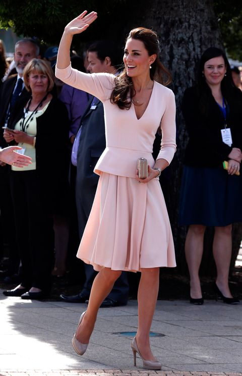 "<p>Alexander McQueen was once again the Duchess' designer of choice for her Adelaide stop-off. Kate wears a soft pink, long-sleeved, V-neck top with a peplum detail, and a pleated A-line skirt.</p> <p><strong>MORE ROYAL SHENANIGANS:</strong></p> <p><a href=""http://www.cosmopolitan.co.uk/fashion/kate-middletons-royal-style-109645?click=main_sr"" target=""_blank"">KATE MIDDLETON'S ROYAL STYLE CV</a></p> <p><a href=""http://www.cosmopolitan.co.uk/celebs/celebrity-gossip/kate-middleton-prince-william-george-photo?click=main_sr"" target=""_blank"">BABY GEORGE'S FIRST OFFICIAL PIC</a></p> <p><a href=""http://www.cosmopolitan.co.uk/love-sex/cosmo-centerfolds/prince-harry-william-lookalikes-naked-centrefolds?click=main_sr"" target=""_blank"">THE PRINCES STRIP FOR COSMO</a></p>"