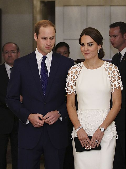 "The Duchess looks stunning in a white cocktail dress by Lela Rose. The lace trim gown features a striking peplum detail at the waist.<p><strong>MORE ROYAL SHENANIGANS:</strong></p><p><a href=""http://www.cosmopolitan.co.uk/fashion/kate-middletons-royal-style-109645?click=main_sr"" target=""_blank"">KATE MIDDLETON'S ROYAL STYLE CV</a></p><p><a href=""http://www.cosmopolitan.co.uk/celebs/celebrity-gossip/kate-middleton-prince-william-george-photo?click=main_sr"" target=""_blank"">BABY GEORGE'S FIRST OFFICIAL PIC</a></p><p><a href=""http://www.cosmopolitan.co.uk/love-sex/cosmo-centerfolds/prince-harry-william-lookalikes-naked-centrefolds?click=main_sr"" target=""_blank"">THE PRINCES STRIP FOR COSMO</a></p>"