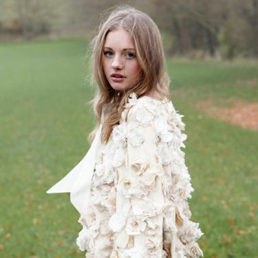 """<p>Finnish designer Minna Hepburn makes ethical, handmade and vintage-inspired bridal wear. You'll want to wear this stunning cape long after the wedding.</p><p>Emma Flower cape, £550, <a href=""""http://www.minna.co.uk/shop/product/emma-flower-cape"""" target=""""_blank"""">Minna.co.uk</a></p><p><a href=""""http://www.cosmopolitan.co.uk/fashion/shopping/12-incredible-high-street-wedding-dresses-budget"""" target=""""_blank"""">BEST BRIDAL GOWNS FROM THE HIGH STREET </a></p><p><a href=""""http://www.cosmopolitan.co.uk/fashion/shopping/short-bridesmaids-dresses-wear-again-uk"""" target=""""_blank"""">SHORT BRIDESMAID DRESSES YOU CAN WEAR AGAIN </a></p><p><a href=""""http://www.cosmopolitan.co.uk/fashion/shopping/v-a-wedding-dress-bridal-exhibition-pictures-2014"""" target=""""_blank"""">IN PICTURES: V&A WEDDING DRESS EXHIBITION</a></p>"""