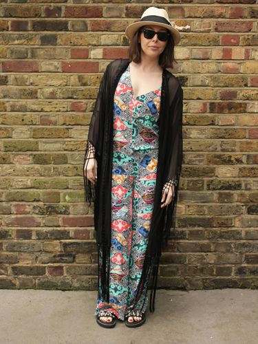 """<p>Jumpsuit, Asos. Fringed shawl, Unif at Urban Outfitters. Straw hat, H&M. Slides, Kurt Geiger.</p> <p><a href=""""http://www.cosmopolitan.co.uk/fashion/shopping/What-to-pack-for-the-festivals-glastonbury-primavera"""" target=""""_blank"""">WHAT TO PACK FOR THE FESTIVALS</a></p> <p><a href=""""http://www.cosmopolitan.co.uk/fashion/shopping/Coachella-festival-street-style-2014-pictures"""" target=""""_blank"""">COACHELLA STREET STYLE HIGHLIGHTS</a></p> <p><a href=""""http://www.cosmopolitan.co.uk/fashion/shopping/Street-style-london-spring-trends-2014-pictures"""" target=""""_blank"""">MORE STREET STYLE INSPIRATION</a></p> <p>Picture by Charlie Ashfield.</p>"""
