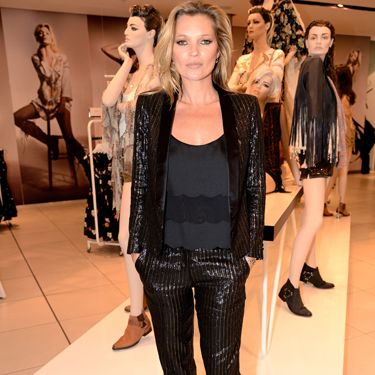 """<p>Kate chooses a sharp two piece suit to launch her collection.</p><p><a href=""""http://www.cosmopolitan.co.uk/fashion/shopping/Kate-Moss-Topshop-collection-spring-summer-2014-best-pieces"""" target=""""_blank"""">KATE MOSS FOR TOPSHOP: WHAT WE'LL BE BUYING</a></p><p><a href=""""http://www.cosmopolitan.co.uk/fashion/news/Cara-Delevingne-stars-in-Kate-Moss-for-Topshop-film"""" target=""""_blank"""">CARA SHOWS MOSSY SOME LOVE IN FASHION FILM</a></p><p><a href=""""http://www.cosmopolitan.co.uk/fashion/shopping/What-to-pack-for-the-festivals-glastonbury-primavera"""" target=""""_blank"""">WHAT TO PACK FOR THE FESTIVALS</a></p>"""