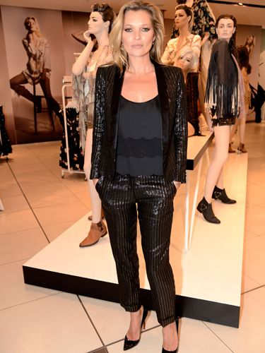 """<p>Kate chooses a sharp two piece suit to launch her collection.</p> <p><a href=""""http://www.cosmopolitan.co.uk/fashion/shopping/Kate-Moss-Topshop-collection-spring-summer-2014-best-pieces"""" target=""""_blank"""">KATE MOSS FOR TOPSHOP: WHAT WE'LL BE BUYING</a></p> <p><a href=""""http://www.cosmopolitan.co.uk/fashion/news/Cara-Delevingne-stars-in-Kate-Moss-for-Topshop-film"""" target=""""_blank"""">CARA SHOWS MOSSY SOME LOVE IN FASHION FILM</a></p> <p><a href=""""http://www.cosmopolitan.co.uk/fashion/shopping/What-to-pack-for-the-festivals-glastonbury-primavera"""" target=""""_blank"""">WHAT TO PACK FOR THE FESTIVALS</a></p>"""