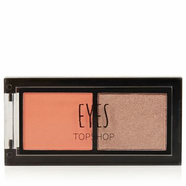 """<p>We go to great lengths to ensure fake tan never turns our skin orange, but pop the shade on eyes and it has a brightening effect. Which why we've fallen for this eye duo from the beauty brains at Topshop, who seem to have their finger on the pulse of the biggest makeup trends.<br /><br />This duo is night eyes in one palette and looks great against blue tones, simply prime your lids and sweep on the orange right up to the eye socket. If you want more definition, work the dark shade through the crease, or create a pretty, rose gold effect by sweeping over the orange shade. Dreamy.</p><p><a href=""""http://www.topshop.com/webapp/wcs/stores/servlet/ProductDisplay?beginIndex=0&viewAllFlag=&catalogId=33057&storeId=12556&productId=14219063&langId=-1&categoryId=&parent_category_rn=&searchTerm=TS20T02FCOR&resultCount=1&geoip=home"""" target=""""_blank"""">Topshop Long Weekend Eye Duo, £6</a></p>"""