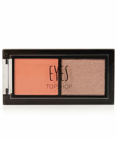 "<p>We go to great lengths to ensure fake tan never turns our skin orange, but pop the shade on eyes and it has a brightening effect. Which why we've fallen for this eye duo from the beauty brains at Topshop, who seem to have their finger on the pulse of the biggest makeup trends.<br /><br />This duo is night eyes in one palette and looks great against blue tones, simply prime your lids and sweep on the orange right up to the eye socket. If you want more definition, work the dark shade through the crease, or create a pretty, rose gold effect by sweeping over the orange shade. Dreamy.</p> <p><a href=""http://www.topshop.com/webapp/wcs/stores/servlet/ProductDisplay?beginIndex=0&viewAllFlag=&catalogId=33057&storeId=12556&productId=14219063&langId=-1&categoryId=&parent_category_rn=&searchTerm=TS20T02FCOR&resultCount=1&geoip=home"" target=""_blank"">Topshop Long Weekend Eye Duo, £6</a></p>"