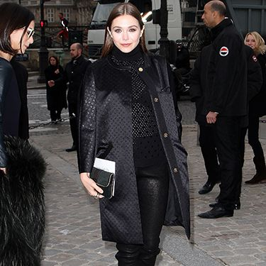 <p>This is the way to style out leather trousers at Paris Fashion Week. Black court heels, sheer mesh polo neck and a jacquard print collarless coat. Elizabeth Olsen - a style maven in our eyes - looks tres chic especially with her slicked down hair and dark nude lips. Definitely try this at home.</p>