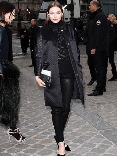 """<p>This is the way to style out leather trousers at Paris Fashion Week. Black court heels, sheer mesh polo neck and a jacquard print collarless coat. Elizabeth Olsen - a style maven in our eyes - looks tres chic especially with her slicked down hair and dark nude lips. Definitely try this at home.</p> <p><a href=""""http://www.cosmopolitan.co.uk/fashion/shopping/how-to-shop-for-vintage-clothes-expert-tips"""" target=""""_blank"""">HOW TO SHOP FOR VINTAGE CLOTHES</a></p> <p><a href=""""http://www.cosmopolitan.co.uk/fashion/shopping/how-to-style-animal-print-trend"""" target=""""_blank"""">7 WAYS TO STYLE ANIMAL PRINT</a></p> <p><a href=""""http://www.cosmopolitan.co.uk/fashion/shopping/10-wedding-guest-outfits-from-the-high-street"""" target=""""_blank"""">10 WEDDING GUEST OUTFITS</a></p>"""