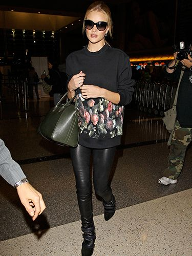 """<p>A fantastic way of dressing down leathers without going to casual - heeled boots, a floral printed black sweatshirt, 'It' bag and oversized glasses. RHW, you babe.</p> <p><a href=""""http://www.cosmopolitan.co.uk/fashion/shopping/how-to-shop-for-vintage-clothes-expert-tips"""" target=""""_blank"""">HOW TO SHOP FOR VINTAGE CLOTHES</a></p> <p><a href=""""http://www.cosmopolitan.co.uk/fashion/shopping/how-to-style-animal-print-trend"""" target=""""_blank"""">7 WAYS TO STYLE ANIMAL PRINT</a></p> <p><a href=""""http://www.cosmopolitan.co.uk/fashion/shopping/10-wedding-guest-outfits-from-the-high-street"""" target=""""_blank"""">10 WEDDING GUEST OUTFITS</a></p>"""