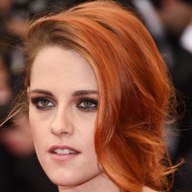 """<p>Kristen's new(ish) orange hair looked gorgeous in a side-parted fishtail plait. While her hair was girlie, her makeup was grunge&#x3B; featuring a wet-look smoky eye.</p><p><a href=""""http://www.cosmopolitan.co.uk/fashion/news/kendall-jenner-wears-topshop-to-met-ball-gala"""" target=""""_blank"""">KENDALL JENNER WEARS TOPSHOP AT THE MET BALL</a></p><p><a href=""""http://www.cosmopolitan.co.uk/fashion/news/met-gala-2014-red-carpet-dresses"""" target=""""_blank"""">THE FULL MET BALL 2014 RED CARPET</a></p><p><a href=""""http://www.cosmopolitan.co.uk/celebs/celebrity-gossip/10-favourite-met-ball-instagrams"""" target=""""_blank"""">BEHIND THE SCENES OF THE MET BALL IN CELEBRITY INSTAGRAMS</a></p>"""