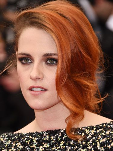 """<p>Kristen's new(ish) orange hair looked gorgeous in a side-parted fishtail plait. While her hair was girlie, her makeup was grunge; featuring a wet-look smoky eye.</p> <p><a href=""""http://www.cosmopolitan.co.uk/fashion/news/kendall-jenner-wears-topshop-to-met-ball-gala"""" target=""""_blank"""">KENDALL JENNER WEARS TOPSHOP AT THE MET BALL</a></p> <p><a href=""""http://www.cosmopolitan.co.uk/fashion/news/met-gala-2014-red-carpet-dresses"""" target=""""_blank"""">THE FULL MET BALL 2014 RED CARPET</a></p> <p><a href=""""http://www.cosmopolitan.co.uk/celebs/celebrity-gossip/10-favourite-met-ball-instagrams"""" target=""""_blank"""">BEHIND THE SCENES OF THE MET BALL IN CELEBRITY INSTAGRAMS</a></p>"""
