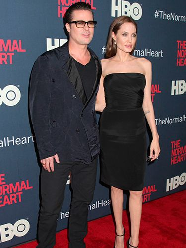 "<p>Despite her slight makeup malfunction, Maleficent actress Angelina looked flawless in a strapless LBD and with our fave accessory, Brad Pitt. Natch.</p> <p><a href=""http://www.cosmopolitan.co.uk/fashion/shopping/celebs-looking-amazing-in-leather-trousers"" target=""_blank"">HOW TO WEAR LEATHER TROUSERS</a></p> <p><a href=""http://www.cosmopolitan.co.uk/fashion/shopping/15-times-caroline-flack-looked-amazing"" target=""_blank"">15 TIMES CAROLINE FLACK LOOKED AMAZING</a></p> <p><a href=""http://www.cosmopolitan.co.uk/fashion/shopping/how-to-shop-for-vintage-clothes-expert-tips"" target=""_blank"">HOW TO SHOP FOR VINTAGE CLOTHES</a></p>"