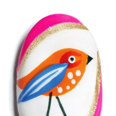 <p><strong>Using Max factor Glossfinity </strong></p><p><strong>1.</strong> Paint the entire nail with a white base.</p><p><strong>2.</strong> When dry, use a bright orange polish to paint a teardrop shape for the bird's body.</p><p><strong>3.</strong> When dry, create a red 'C' shape for the base of the eye and an overlapping blue wing. You might want to invest in a small nail art brush for these details.</p><p><strong>4.</strong> When dry, use a white polish and striping brush to add detail to the wing, and use a dotter to dot the eye and breast of the bird.</p><p><strong>5.</strong> Use a black polish and striping brush to draw the legs and beak, and a dotter to dot the eye.</p><p><strong>6.</strong> Frame the outer edges of the nail with a pink and glitter polish using a striper brush.</p>