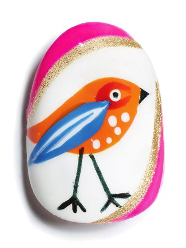 <p><strong>Using Max factor Glossfinity </strong></p> <p><strong>1.</strong> Paint the entire nail with a white base.</p> <p><strong>2.</strong> When dry, use a bright orange polish to paint a teardrop shape for the bird's body.</p> <p><strong>3.</strong> When dry, create a red 'C' shape for the base of the eye and an overlapping blue wing. You might want to invest in a small nail art brush for these details.</p> <p><strong>4.</strong> When dry, use a white polish and striping brush to add detail to the wing, and use a dotter to dot the eye and breast of the bird.</p> <p><strong>5.</strong> Use a black polish and striping brush to draw the legs and beak, and a dotter to dot the eye.</p> <p><strong>6.</strong> Frame the outer edges of the nail with a pink and glitter polish using a striper brush.</p>