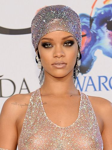 "<p>If you managed to lift your eyes away from all the nakedness, you'll have noticed Rihanna brought it with a smokey makeup look. Sooty shadow swathed her lids in a deep, flattering wing, while lips boasted barely-there hues in a milky, neutral gloss.</p> <p><a href=""http://www.cosmopolitan.co.uk/fashion/news/rihanna-see-through-dress-CFDAS"" target=""_blank"">YOU HAVE TO SEE RIHANNA'S CFDA OUTFIT</a></p> <p><a href=""http://www.cosmopolitan.co.uk/beauty-hair/news/styles/hair-trends-spring-summer-2014?click=main_sr"" target=""_blank"">THE HUGE HAIR TRENDS FOR 2014</a></p> <p><a href=""http://www.cosmopolitan.co.uk/beauty-hair/news/trends/spring-summer-2014-beauty-trends?click=main_sr"" target=""_blank"">SPRING/SUMMER 2014 BEAUTY TRENDS REPORT</a></p>"