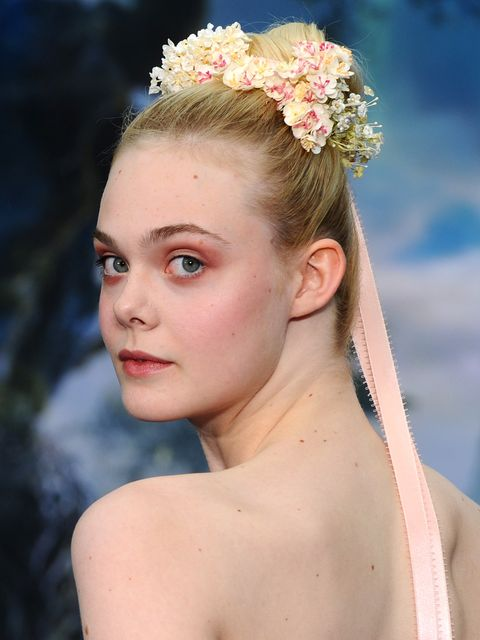 "<p>It's only fitting Elle Fanning wore this look to promote Maleficent; the floral crown looping around her bun is a true fairytale look. And while we don't expect you to adorn yourself in ribbons like a Maypole, adding flowers to a tight topknot makes a great festival 'do.</p> <p><a href=""http://www.cosmopolitan.co.uk/beauty-hair/beauty-tips/wedding-hair-inspiration-how-to-choose-hair-accessory?click=main_sr"" target=""_blank"">HOW TO CHOOSE A WEDDING HAIR ACCESSORY</a></p> <p><a href=""http://www.cosmopolitan.co.uk/beauty-hair/news/styles/hair-trends-spring-summer-2014?click=main_sr"" target=""_blank"">THE HUGE HAIR TRENDS FOR 2014</a></p> <p><a href=""http://www.cosmopolitan.co.uk/beauty-hair/news/beauty-news/how-to-do-festival-plait-hairstyle?click=main_sr"" target=""_blank"">HAIR HOW-TO: FESTIVAL PLAITS</a></p>"