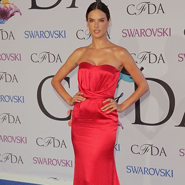 <p>Major Victoria Secret Angel jealousy. The gorgeous Alessandra Ambrosio looked flawless in this vibrant red strapless gown by Nonoo, pairing it with Jennifer Fisher jewellery.</p>