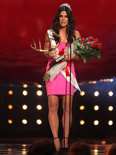 "<p>Sandra Bullock was adorned with all kinds of <em>Miss Congeniality </em>paraphernalia to collect her 'Decade of Hotness' award at the ceremony, and hot she looks indeed in her bold pink strapless dress.</p> <p><a href=""http://www.cosmopolitan.co.uk/fashion/news/best-of-the-cfda-red-carpet?page=1"" target=""_blank"">15 BEST DRESSED AT THE CFDA AWARDS</a></p> <p><a href=""http://www.cosmopolitan.co.uk/celebs/entertainment/rihanna-hits-back-at-critics-over-that-nipple-baring-dress?click=main_sr"" target=""_blank"">RIHANNA'S CONTROVERSIAL SEE-THROUGH DRESS</a></p> <p><a href=""http://www.cosmopolitan.co.uk/fashion/shopping/festival-season-essentials"" target=""_blank"">FESTIVAL SEASON FASHION ESSENTIALS</a></p>"