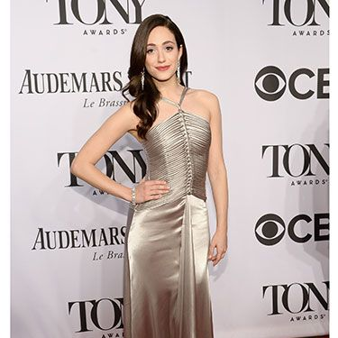 """<p>Actress Emmy Rossum looked gorgeous in a floor-length champagne silk dress to present an award at the Tony's ceremony. We think the knotted bodice of her gown along with the halterneck looks every bit <em>glorious</em> on her.</p><p><a href=""""http://www.cosmopolitan.co.uk/fashion/guys-awards-red-carpet-looks"""" target=""""_blank"""">THE BEST LOOKS FROM THE GUYS' CHOICE AWARDS</a></p><p><a href=""""http://www.cosmopolitan.co.uk/fashion/news/best-of-the-cfda-red-carpet?page=1"""" target=""""_blank"""">HOTTEST RED CARPET LOOKS AT THE CFDAS</a></p><p><a href=""""http://www.cosmopolitan.co.uk/fashion/shopping/ten-of-the-best-summer-shoes"""" target=""""_blank"""">10 OF THE BEST SUMMER SHOES</a></p>"""