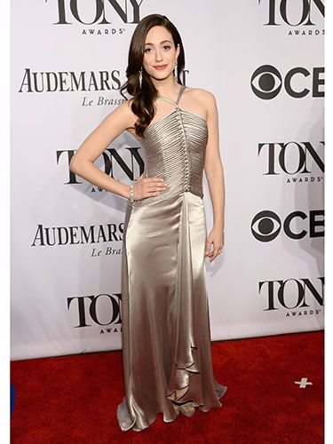 "<p>Actress Emmy Rossum looked gorgeous in a floor-length champagne silk dress to present an award at the Tony's ceremony. We think the knotted bodice of her gown along with the halterneck looks every bit <em>glorious</em> on her.</p> <p><a href=""http://www.cosmopolitan.co.uk/fashion/guys-awards-red-carpet-looks"" target=""_blank"">THE BEST LOOKS FROM THE GUYS' CHOICE AWARDS</a></p> <p><a href=""http://www.cosmopolitan.co.uk/fashion/news/best-of-the-cfda-red-carpet?page=1"" target=""_blank"">HOTTEST RED CARPET LOOKS AT THE CFDAS</a></p> <p><a href=""http://www.cosmopolitan.co.uk/fashion/shopping/ten-of-the-best-summer-shoes"" target=""_blank"">10 OF THE BEST SUMMER SHOES</a></p>"