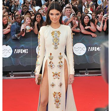 <p>Risqué was most definitely the name of Kendall's game with this showstopping number. No need for knickers with the adventurous cut of her embellished cream gown. Thank goodness there wasn't too strong a wind in downtown Toronto, eh, or we might all have seen a bit more than we bargained for...</p>