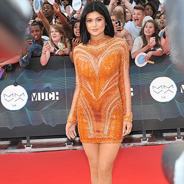 <p>Kylie Jenner stood out in this bright orange, long-sleeved mini dress. The Kardashian/Jenners are certainly loving their embellished dresses at the moment, and so are we. A hit, we think.</p>