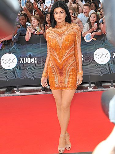 "<p>Kylie Jenner stood out in this bright orange, long-sleeved mini dress. The Kardashian/Jenners are certainly loving their embellished dresses at the moment, and so are we. A hit, we think.</p> <p><a href=""http://www.cosmopolitan.co.uk/fashion/news/get-the-look-fearne-cotton-floral-dress"" target=""_blank"">FEARNE COTTON'S GORGEOUS DRESS IS LESS THAN £30 ON THE HIGH STREET</a></p> <p><a href=""http://www.cosmopolitan.co.uk/fashion/news/swimwear-bikinis-small-busts-boobs"" target=""_blank"">SUMMER SWIMWEAR FOR SMALL BREASTS</a></p> <p><a href=""http://www.cosmopolitan.co.uk/fashion/news/swimwear-bikinis-big-curvy-busts-boobs"" target=""_blank"">SUMMER SWIMWEAR FOR BIG BREASTS</a></p>"