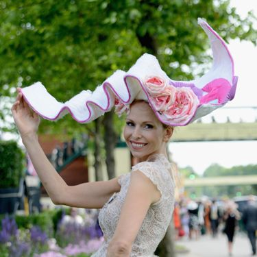 """<p>We bet she's been waiting for just the right occasion to wear her favourite two metre wide hat. What could be a better place than at the Royal Ascot?</p><p><a href=""""http://www.cosmopolitan.co.uk/fashion/news/floppy-hat-trend?click=main_sr"""" target=""""_blank"""">THE RETURN OF THE HAT - THE MOST ON TREND STYLES</a></p><p><a href=""""http://www.cosmopolitan.co.uk/fashion/news/milliner-stephen-jones-on-new-debenhams-collection-and-hat-wearing-etiquette?click=main_sr"""" target=""""_blank"""">MILLINER STEPHEN JONES ON HAT-WEARING ETIQUETTE</a></p><p><a href=""""http://www.cosmopolitan.co.uk/fashion/shopping/isle-of-wight-festival-what%27s-in-your-bag"""" target=""""_blank"""">WHAT'S IN YOUR FESTIVAL BAG?</a></p>"""