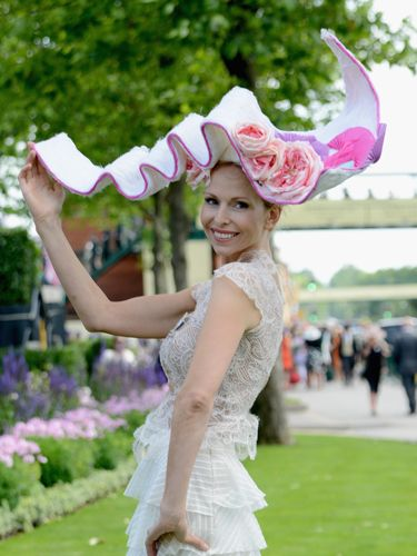 "<p>We bet she's been waiting for just the right occasion to wear her favourite two metre wide hat. What could be a better place than at the Royal Ascot?</p> <p><a href=""http://www.cosmopolitan.co.uk/fashion/news/floppy-hat-trend?click=main_sr"" target=""_blank"">THE RETURN OF THE HAT - THE MOST ON TREND STYLES</a></p> <p><a href=""http://www.cosmopolitan.co.uk/fashion/news/milliner-stephen-jones-on-new-debenhams-collection-and-hat-wearing-etiquette?click=main_sr"" target=""_blank"">MILLINER STEPHEN JONES ON HAT-WEARING ETIQUETTE</a></p> <p><a href=""http://www.cosmopolitan.co.uk/fashion/shopping/isle-of-wight-festival-what%27s-in-your-bag"" target=""_blank"">WHAT'S IN YOUR FESTIVAL BAG?</a></p>"
