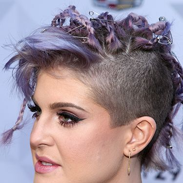 <p>What's a brave beauty story without a Kelly Osbourne? The lilac shade, punky plaits, randomly placed safety pins and shaved side section all sum up her wacky style perfectly. </p>