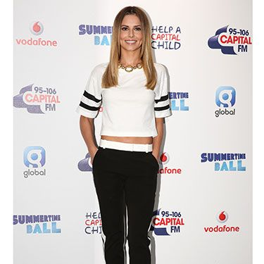 <p>Cheryl was rocking the sports-luxe look at Saturday's Summertime Ball&#x3B; wearing a cropped white Karl Lagerfeld top with black jogging trousers to match. Her hair was super-sleek, and she glammed up her look further with some lace-up heels. We <em>love </em>this look on Cheryl.</p>