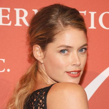 """<p>A low-slung pony with a deep side sweep makes the most of pretty, natural waves, creating a soft, romantic style as seen on Doutzen Kroes. Make like the model with a touch of volume teased throughout the crown&#x3B; you can do this with light backcombing before you pull lengths into the ponytail.</p><p><a href=""""http://www.cosmopolitan.co.uk/beauty-hair/news/styles/celebrity/celebrity-plaits-and-braids"""" target=""""_blank"""">PRETTY PLAITS AND BEAUTIFUL BRAIDS</a></p><p><a href=""""http://www.cosmopolitan.co.uk/beauty-hair/news/trends/celebrity-beauty/female-celebrities-with-hot-undercuts"""" target=""""_blank"""">CELEBRITIES WITH HOT UNDERCUTS</a></p><p><a href=""""http://www.cosmopolitan.co.uk/beauty-hair/news/styles/hair-trends-spring-summer-2014"""" target=""""_blank"""">HUGE HAIR TRENDS FOR 2014</a></p>"""