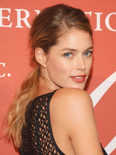 "<p>A low-slung pony with a deep side sweep makes the most of pretty, natural waves, creating a soft, romantic style as seen on Doutzen Kroes. Make like the model with a touch of volume teased throughout the crown; you can do this with light backcombing before you pull lengths into the ponytail.</p> <p><a href=""http://www.cosmopolitan.co.uk/beauty-hair/news/styles/celebrity/celebrity-plaits-and-braids"" target=""_blank"">PRETTY PLAITS AND BEAUTIFUL BRAIDS</a></p> <p><a href=""http://www.cosmopolitan.co.uk/beauty-hair/news/trends/celebrity-beauty/female-celebrities-with-hot-undercuts"" target=""_blank"">CELEBRITIES WITH HOT UNDERCUTS</a></p> <p><a href=""http://www.cosmopolitan.co.uk/beauty-hair/news/styles/hair-trends-spring-summer-2014"" target=""_blank"">HUGE HAIR TRENDS FOR 2014</a></p>"