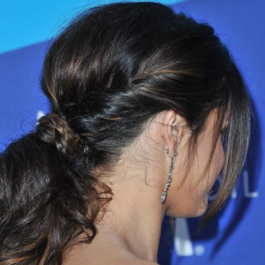 """<p>Is there anything more romantic than this weaved and twisted style? Selena Gomez gave a great lesson in intricate bridal hair. With a centre part and loose tendrils that lightly frame her face, she's folded rope twists on either side of her head into a glossy pony tail. The finishing touch? Her lengths are loose with a pretty plait that conceals the band, making this the perfect ponytail for those with longer locks.</p><p><a href=""""http://www.cosmopolitan.co.uk/beauty-hair/news/styles/celebrity/celebrity-plaits-and-braids"""" target=""""_blank"""">PRETTY PLAITS AND BEAUTIFUL BRAIDS</a></p><p><a href=""""http://www.cosmopolitan.co.uk/beauty-hair/news/trends/celebrity-beauty/female-celebrities-with-hot-undercuts"""" target=""""_blank"""">CELEBRITIES WITH HOT UNDERCUTS</a></p><p><a href=""""http://www.cosmopolitan.co.uk/beauty-hair/news/styles/hair-trends-spring-summer-2014"""" target=""""_blank"""">HUGE HAIR TRENDS FOR 2014</a></p>"""