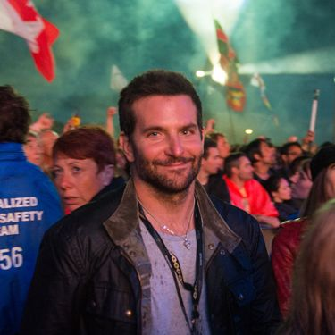 <p>With an 'okay, you caught me' look on his face, Bradley Cooper takes in Metallica. We bet he thought he'd gone incognito before this photographer snapped his pic.</p>