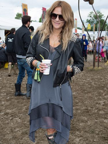 """<p>Another star who never lets a festival go missed, Caroline Flack has mud-traipsing style down to an utter tee. Toughening up a floaty dress with a studded leather jacket, she's hitting a festival theme with this look; splattered Hunter boots.</p> <p><a href=""""http://www.cosmopolitan.co.uk/celebs/entertainment/2014-music-festival-guide"""" target=""""_blank"""">THE 2014 MUSIC FESTIVAL GUIDE</a></p> <p><a href=""""http://www.cosmopolitan.co.uk/beauty-hair/beauty-tips/the-best-summer-festival-nail-art-designs-how-to"""" target=""""_blank"""">12 OF THE BEST FESTIVAL NAIL ART DESIGNS</a></p> <p><a href=""""http://www.cosmopolitan.co.uk/fashion/shopping/festival-season-essentials"""" target=""""_blank"""">YOUR FESTIVAL SEASON ESSENTIALS</a></p>"""