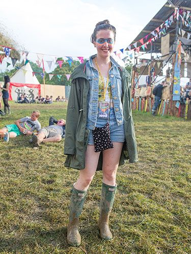 "<p>Kate, 18, is channelling Mutant-Ninja-Turtle-chic and we love it! Wearing all Primark, aside from her Hunter wellies (of course) she looks great wearing a green parka over her high waisted denim shorts and crop top combo. The perfect festival get-up, we think you'll agree.</p> <p><a href=""http://www.cosmopolitan.co.uk/fashion/news/festival-fashion-street-style-isle-of-wight"" target=""_blank"">ISLE OF WIGHT FESTIVAL STREET STYLE</a></p> <p><a href=""http://www.cosmopolitan.co.uk/celebs/celebrity-gossip/celebrities-at-glastonbury-festival-2014"" target=""_blank"">CELEBRITIES AT GLASTONBURY 2014</a></p> <p><a href=""http://www.cosmopolitan.co.uk/campus/summer-full-festivals-cheap-volunteering"" target=""_blank"">HOW TO NAB A SUMMER FULL OF FESTIVALS ON THE CHEAP</a></p>"