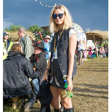 <p>23-year-old Claire is a fashion student and it shows! Opting for a leather look, she's customised her vintage skirt and teamed it with a black sleveless denim jacket that gives an enviable rocky edge.</p>