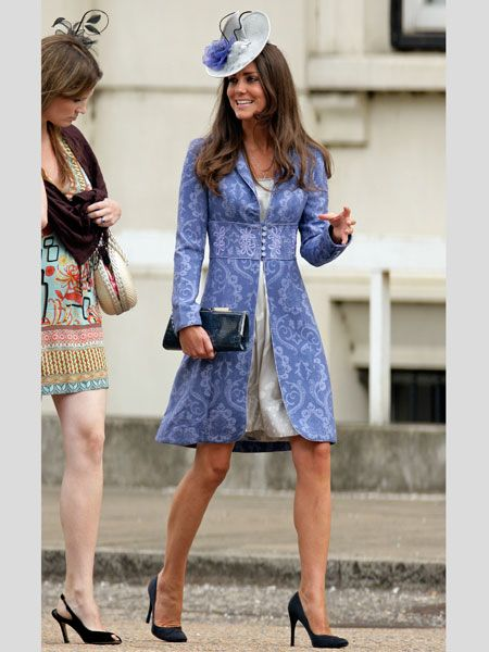 By August 2009 Kate had her royal style set and worked this sophisticated lilac jacket over a shimmering silver dress. Attending another society wedding at Wellington Barracks Kate chose navy accessories and a lilac and silver fascinator. Simply stunning!<br />