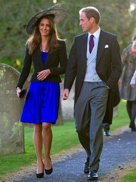 "<p>Showing off her althetic figure in a midnight blue dress Kate attended a wedding with Prince William by her side earlier this year. What a lovely couple they make. All together now... ahhhhhhh  <br /><br /><a href=""http://www.cosmopolitan.co.uk/your-life/the-cost-of-the-royal-wedding/v1"">Now have your say on today's big issue: should the public foot the security bill for the royal wedding?</a></p><p> </p><p><a href=""http://www.cosmopolitan.co.uk/fashion-&-style/kate-middleton-possible-dresses/gallery"">CHECK OUT KATE'S WEDDING DRESS POSSIBILITIES</a> <br /></p>"